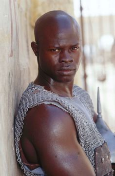 Djimon Hounsou as Juba in Gladiator Gladiator 2000, Gladiator Film, Djimon Hounsou, Russell Crowe, Ridley Scott, Por Tv, Handsome Actors, Movie Characters, Storybook Characters