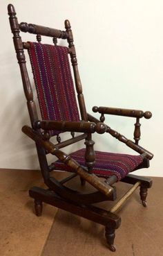 A beautiful old rocker newly polished and upholstered to sit as a family heirloom.