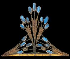 Liberty & Co Tiara by FREDERICK JAMES PARTRIDGE.  A tiara cleverly arranged to suggest barley corns glistening with the morning dew. Carved from cow's horn and set with moonstones'  Original fitted case by Liberty & co. Tadema Gallery