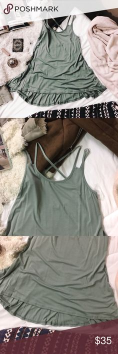 Sage Modal Criss cross Cutout layering Tank Sage Modal Criss cross Cutout layering Tank   The Bella top is a sleeveless top featuring cross cross cutout back detail with spaghetti straps and pleated hi-lo hem. This top is made with medium weight premium modal fabric that is very soft, drapes well and has good stretch. Easy to style for any season--easy to layer for fall/winter.   Made of: 95% modal 5% spandex In the color: Sage questforthreads Tops