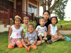 Children and their mother, SOS Children's Village Chiang Rai, Thailand. SOS-Kinderdorf