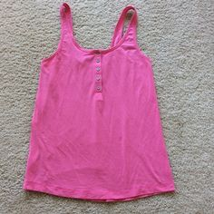 Lululemon Athletic tank Lululemon Athletic tank. Super cute pink color. T shirt type material with a bit of stretch. Probably cotton blend. Super soft. Henley style with the buttons in front. Size 4. Excellent condition.  #246 lululemon athletica Tops Tank Tops