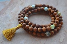 A personal favorite from my Etsy shop https://www.etsy.com/listing/261687515/calming-108-bead-sandalwood-mala-wrist