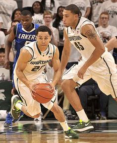 Travis Trice picks up an intercepted pass and heads up court. (Dale G. Young / The Detroit News)