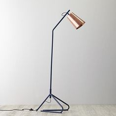 You could say we have high expectations for our Loft floor lamp. The towering dark blue frame and copper colored shade put it above the rest.