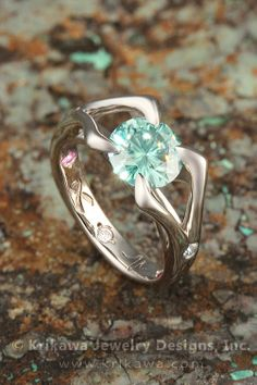 Carved Branch Engagement Ring with green moissanite - beautiful!  Though I might like a garnet in the middle instead... still gorgeous!