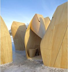 Modern ice-fishing shelters: Each shelter is formed of thin, flexible plywood which is given both structure and spatial character through bending/deformation. Skins, made of 2 layers of 3/16th inch thick flexible plywood, are cut in patterns and attached to a timber armature which consists of a triangular base, and wedge shaped spine and ridge members (the ridge is a line to negate the gravity loads of snow).