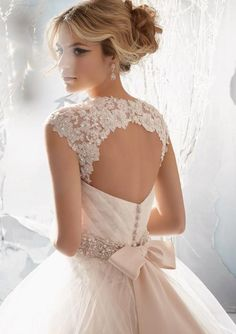 Beautiful delicate lace open back wedding dress. Imagine this with a navy and burlap wedding. Stunning. Not sure who the designer is though.