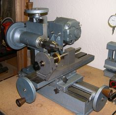 Roussel Horizontal Milling Machine set up with a Lindow latch plate indexing attachment. This machine is used for cutting brass clock wheels.