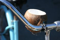 This coconut beverage holder is made in Squamish BC. They attach to the handle bar of your cruiser bike and carry a can of beer perfectly. They are insulated with foam so they keep your bevy cold and they look cool too! Drink Holder, Beverages, Coconut, Handle, Beer, Earth, Cold, Canning, Cool Stuff