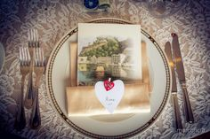 Elegant setup wedding table at the Villa Sant'Andrea. Heart-shaped table card!