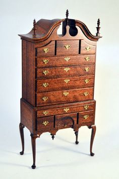 A GORGEOUS REAL WALNUT HIGHBOY CHEST BY GERALD CRAWFORD AND NICHOLE WALTON MARBLE FROM THE COLONIAL WILLIAMSBURG COLLECTION. EACH DRAWER HAS DOVETAILING, FINE BRASS HARDWARE AND FINE FINISHES. FINE THIN CABRIOL LEGS WITH CARVED SPIRE DROPS ON APRON BELOW.   eBay!