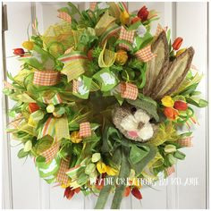 A personal favorite from my Etsy shop https://www.etsy.com/listing/572263220/easter-wreath-easter-bunny-wreath-green