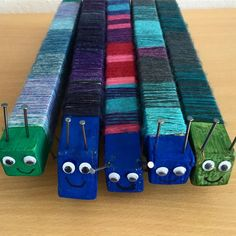 Small millipedes made of pieces of wood nails and colorful wool. For more great home improvement … Colorful Wood Grain Wall Art DIY Yarn Crafts, Wood Crafts, Diy And Crafts, Arts And Crafts, Forest School Activities, Craft Activities For Kids, Yarn Projects, Wood Projects, Woodworking Projects