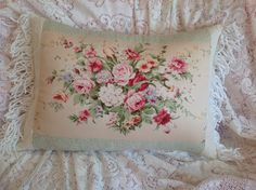 This is a one of a kind pillow cover I recently designed .  Main floral panel is a vintage fabric, framed with a green print cotton and a textured matlasse fabric. Vintage fringe at each end.  Measures:14 x 22 . Other sizes may be available.  Colors: tan background with floral spray in pinks, rose, raspberry, blue and red. Shades of green on leaves and foliage. All cotton.  Back side is a off white cotton.  Envelope style for easy access of your pillow form  Buy with confidence, this is a…