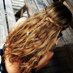 braided hair. beachy waves. Maybe i could get heidi to do this for the dance