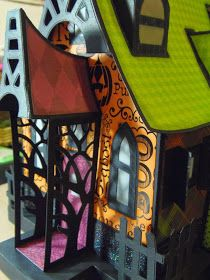 I built two houses in the last week...paper houses that is. I created a couple of haunted houses for Halloween.            Both are made f...