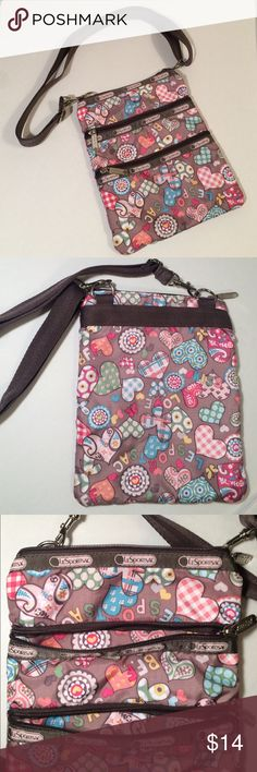 "LeSportsac Nylon 3 Pocket Bag This LeSportsac is in great condition! It is super cute and features a light brown background with BFF, KISS, LESPORTSAC, and hearts printed throughout. The width is approximately 7.5"" and the length of the bag is 9"". This also  has two additional zippered pockets on the outside. The strap is adjustable and has the ability to have 14""-25"" drop. The only flaw is on the inside of the main compartment, which is not visible from the outside. LeSportsac Bags…"