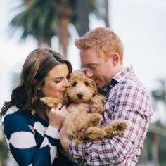 Get ready for a mega-dose of cuteness.  This beautiful couple brought their Labradoodle puppy along for their beachy SoCal engagement shoot! - Tap the pin for the most adorable pawtastic fur baby apparel! You'll love the dog clothes and cat clothes! <3