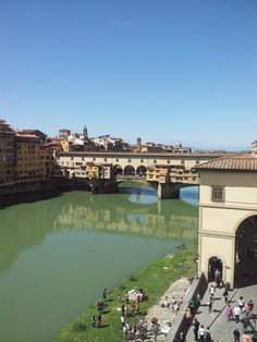 Florence, palazzo vechio - had my photo taken standing near wall with Ponte Vechio in background - lovely city