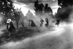 """joeinct: """"Young Mennonite Women Fleeing a Cloud of Dust, Durango, Mexico, Photo by Larry Towell, 1994 """""""