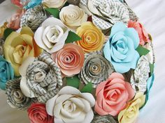 Martas wedding was beautiful, so now I can offer her bouquet design for sale. This bridal bouquet is made up of recycled vintage book page paper roses and multicolored paper cardstock roses and spiral roses for a bright and colorful bouquet. I used teal and coral and ivory and pale