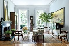 Lippes grouped a custom-made sofa and armchair with a 1960s Paul McCobb cocktail table and a pair of antique Swedish chairs in the living room   archdigest.com