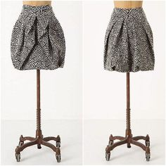 """Anthropologie *RARE* Draped Jungle Skirt Worn once! Super adorable and in excellent condition! Like new! Make me an offer on this lovely brocade Eva Franco piece!  A labyrinth of bold geometric pattern burgeons about this artfully wrapped jacquard skirt by Eva Franco.   Back zip  Cotton, polyester; polyester lining  18""""L  USA  Style No. 20529889 Anthropologie Skirts"""