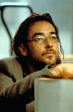 john cusack being john malkovich - Strange movie but how cares Cusack is in it!