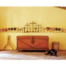 n 18th-century arcón (trunk) from Ecuador anchors the hacienda's sala (living room).  Mr. Puppy, the family dog, keeps a watchful eye on a collection of Mexican dance masks and antique painted crosses.