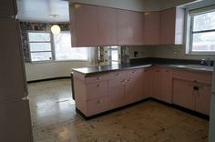 This kitchen is up for grabs right now in Cincinnati, Ohio.  Not only are you looking at pink steel cabinets, look at those fabulous floor tiles, the charcoal grey countertops and.... THAT WALLPAPER!    Allie Weaver on Facebook has just posted this kitchen that they're tearing out of their home.  If you're interested, find her on FB and save this beauty.