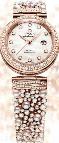 "OMEGA De Ville Ladymatic ""Diamonds & Pearls"" watch with white mother-of-pearl dial and diamond bezel and hand markers set in Sedna gold (trademarked by Omega). (=)"