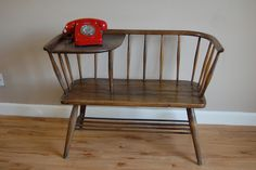 I love Ercol this is a a beautiful Ercol 1950's Telephone table seat