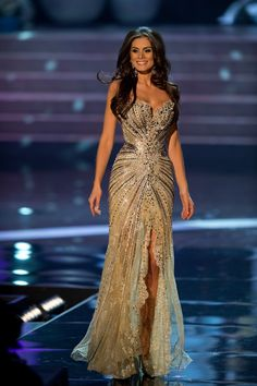 Dresses I wear.  Miss Brazil Universe 2012 – Gabriela Markus. Designed by Brazilian designer Alexandre Dutra, the same designer for Miss Universe 2011 – Leila Lopes' gown. This strapless gown had a unique, symmetrical sequin design which brought your focus inward, and along with the slit down the center, it really looked like she sparkled from within!