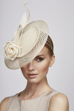 Cream percher, embossed leather with criss cross edging. Trimmed with silk rose, ostrich feather swirl and feather arrow | Juliette Botterill Millinery | Spring-Summer 2014
