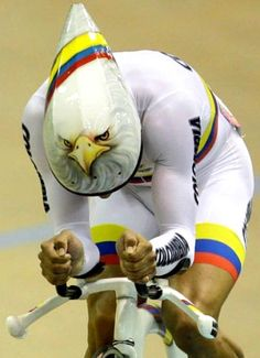 """suitep: """" Golden eagle: Colombia's Juan Arango wins the gold in the men's omnium time trial cycling race at the Pan American Games in Guadalajara. """" I AM IN LIKE WITH THAT HELMET Track Cycling, Cycling Art, Cycling Bikes, Indoor Cycling, Cool Bike Helmets, Bicycle Helmet, Pimp Your Bike, Mtb, Alpe D Huez"""