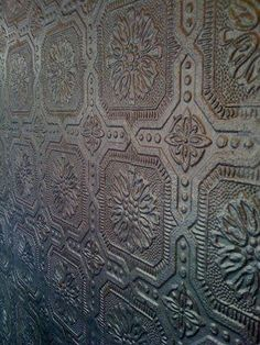 Embossed wallpaper that you can paint. I like this design. Bathroom vanity wall to cover wall imperfections?