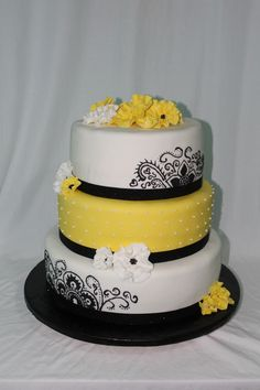 A pretty yellow and black cake to celebrate an 18th Birthday