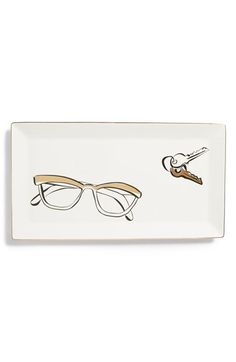 Fanciful graphics brighten a porcelain tray that provides a convenient catchall for your keys, spare change, and other odds and ends.