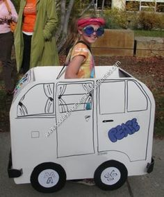 Homemade Hippie in a VW Bus Halloween Costume: The back and sides of the bus are cut from foam core—two rounded shapes for the sides, and rectangles for the front and back. All are fastened into a box-like