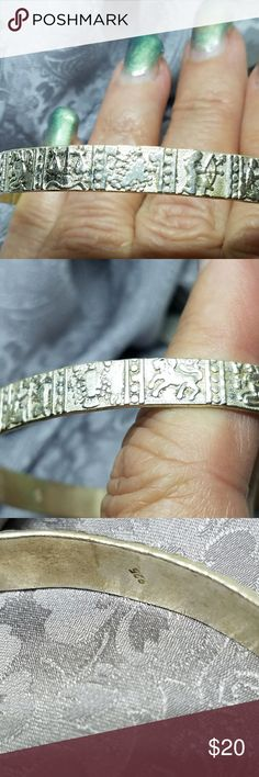 Vintage Horoscope Sterling Silver Bangle Bracelet Fine details in this vintage silver bracelet make it a,standout. Stamped all the way around in the Greek signs of the Zodiac it is a one of a kind estate find. Don't miss this unusual Sterling Silver Bangle with incredible details. Jewelry Bracelets