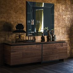 Europa Sideboard by CATTELAN ITALIA Sideboard with sliding doors in Canaletto walnut (NC), burned oak (RB), glossy oyster (L5) or graphite (L6). Structure in matt graphite (OP69). Internal shelves in clear glass. http://www.format-store.com/en/prod/living-area/sideboard-and-container/europa-sideboard-by-cattelan-italia.html