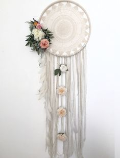 XL dreamcatcher circle is 24 in diameter and measures from top to bottom of longest piece of yarn 50 inches but can be customized to the length