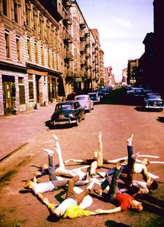 the Jets practice raising their legs in the air in order to assure their continuance in the filming-uh oh! get that leg up Russ Tamblyn! 'West Side Story'