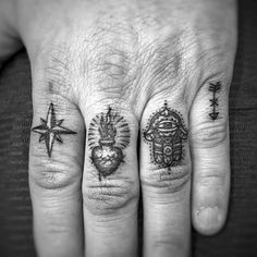 Four Symbols On Mans Hand Finger Tattoos