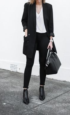 Black outfit with white t-shirt. Love the mix of casual and polished.