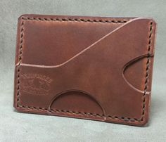 Hand cut and stitched leather minimalist wallet. A minimalist wallet made with quality vegetable tanned leather that features one pocket for I. and cards etc. and a unique cash strap/card holder. Leather Wallet Pattern, Small Leather Wallet, Handmade Leather Wallet, Leather Gifts, Stitching Leather, Leather Pouch, Leather Purses, Leather Card Wallet, Leather Wallets
