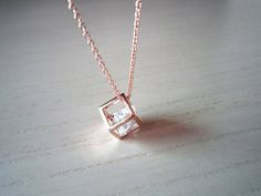 Rose gold and diamond cube necklace.