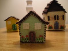 Tiny embroidered felt houses