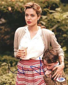 This is an 8x10 Photo that has been hand signed by Angelina Jolie. It has been authenticated by PSA/DNA and comes with their sticker and matching certificate.